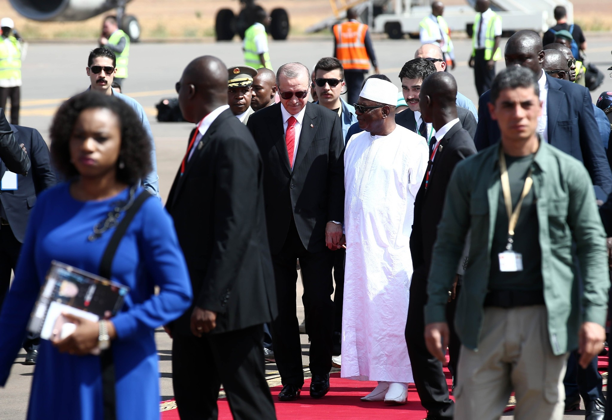 President Erdou011fan and Malian President Keita walk after Erdou011fanu2019s arrival at Bamako airport as part of his diplomatic visits to four African countries, Mali, March 2.