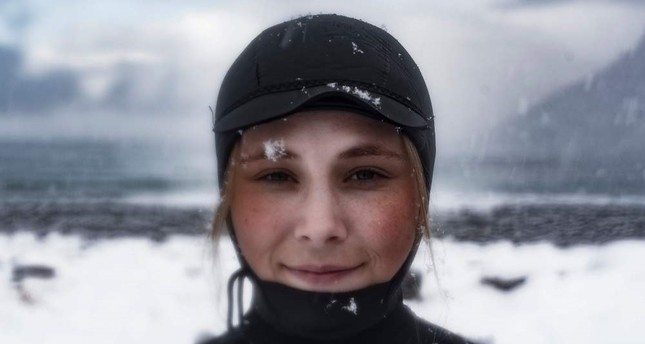 Solmoy Austbo from Norway poses after a surf session in Unstad.