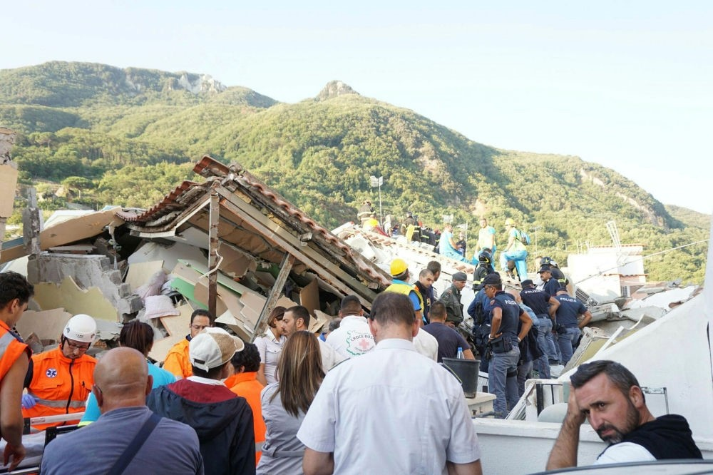 Rescuers at work amongst rubble and damaged houses the day after the earthquake in Ischia, Italy, Aug. 22.