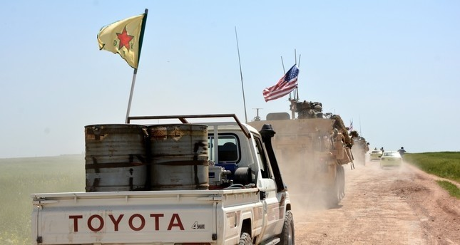 YPG militants and US army personnel cooperate in Syria, despite Turkey's strong objections