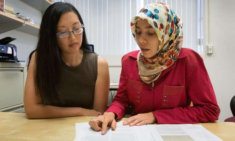 UCLA biologist Elif Tekin (R) with professor Pamela Yeh. (Photo from Reed Hutchinson/UCLA)