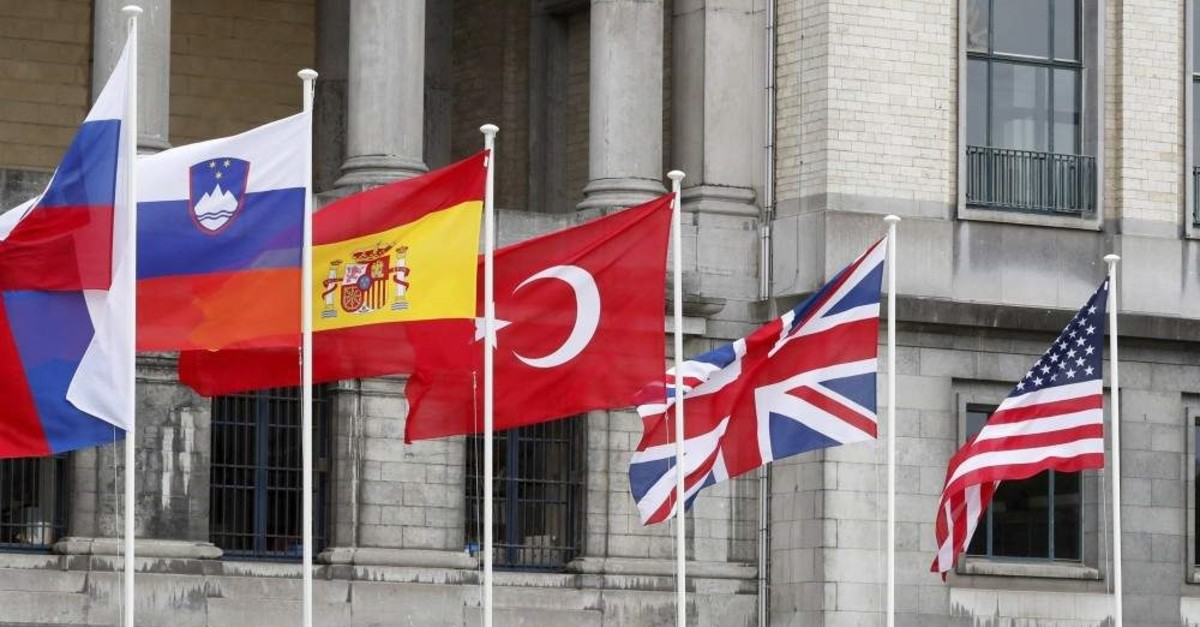 Flags of some of NATO member countries are seen outside the Cinquantenaire, Brussels. (Reuters File Photo)