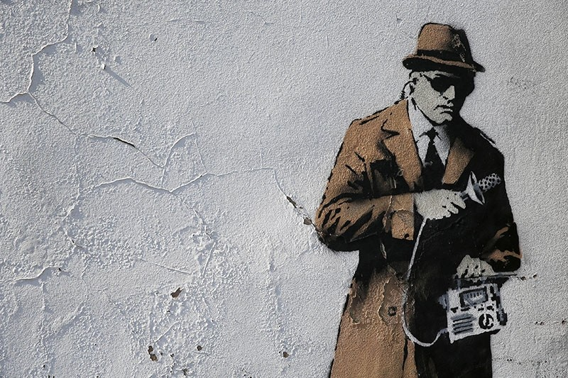 A detail from graffiti art is seen on a wall near the headquarters of Britain's eavesdropping agency, Government Communications Headquarters, known as GCHQ, in Cheltenham, western England. (Reuters Photo)
