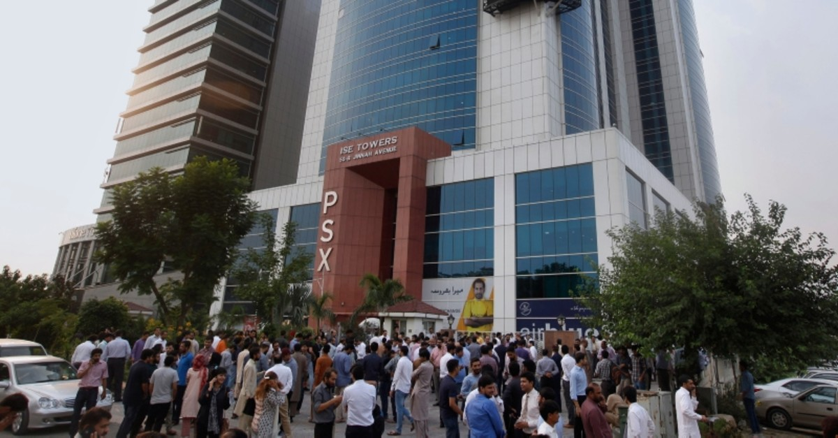 People gather outside their office building after an earthquake is felt in Islamabad, Pakistan, Tuesday, Sept. 24, 2019. (AP Photo)