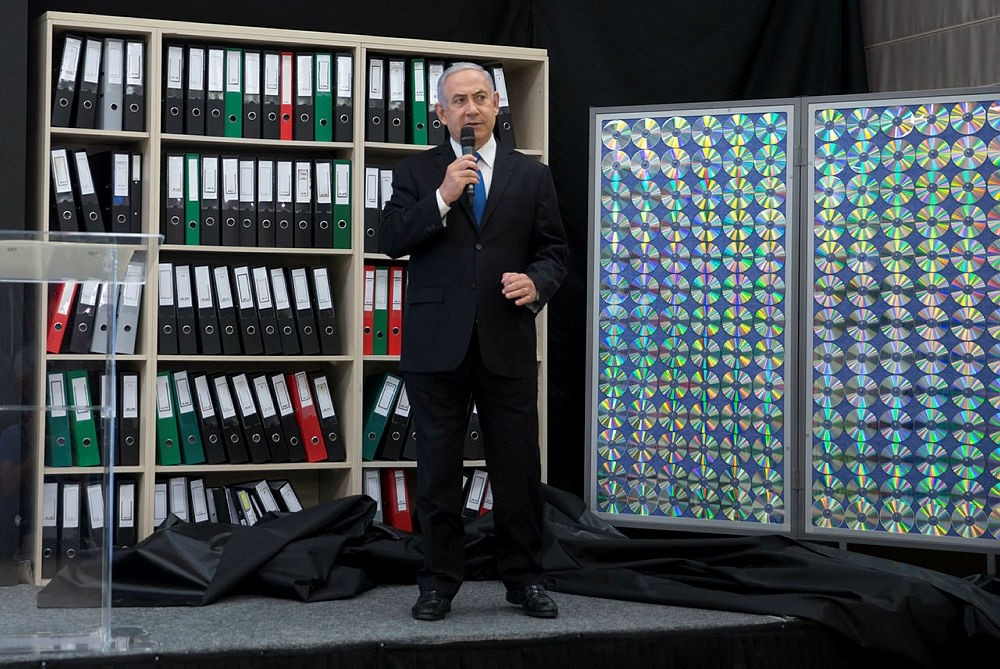 Israeli Prime Minister Benjamin Netanyahu presents material on Iranian nuclear weapons development during a press conference in in Tel Aviv, Israel, Monday, April 30, 2018. (AP Photo)