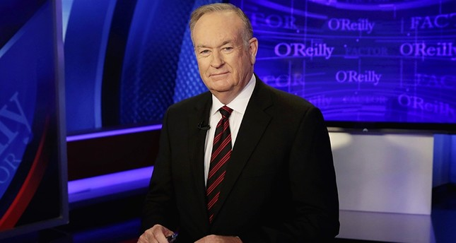 In this Oct. 1, 2015 file photo, host Bill O'Reilly of The O'Reilly Factor on the Fox News Channel, poses for photos in the set in New York. (AP Photo)