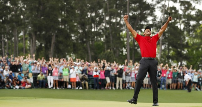 Tiger Woods of the United States celebrates after sinking his putt to win during the final round of the Masters at Augusta National Golf Club on April 14, 2019 in Augusta, Georgia. (AFP Photo)