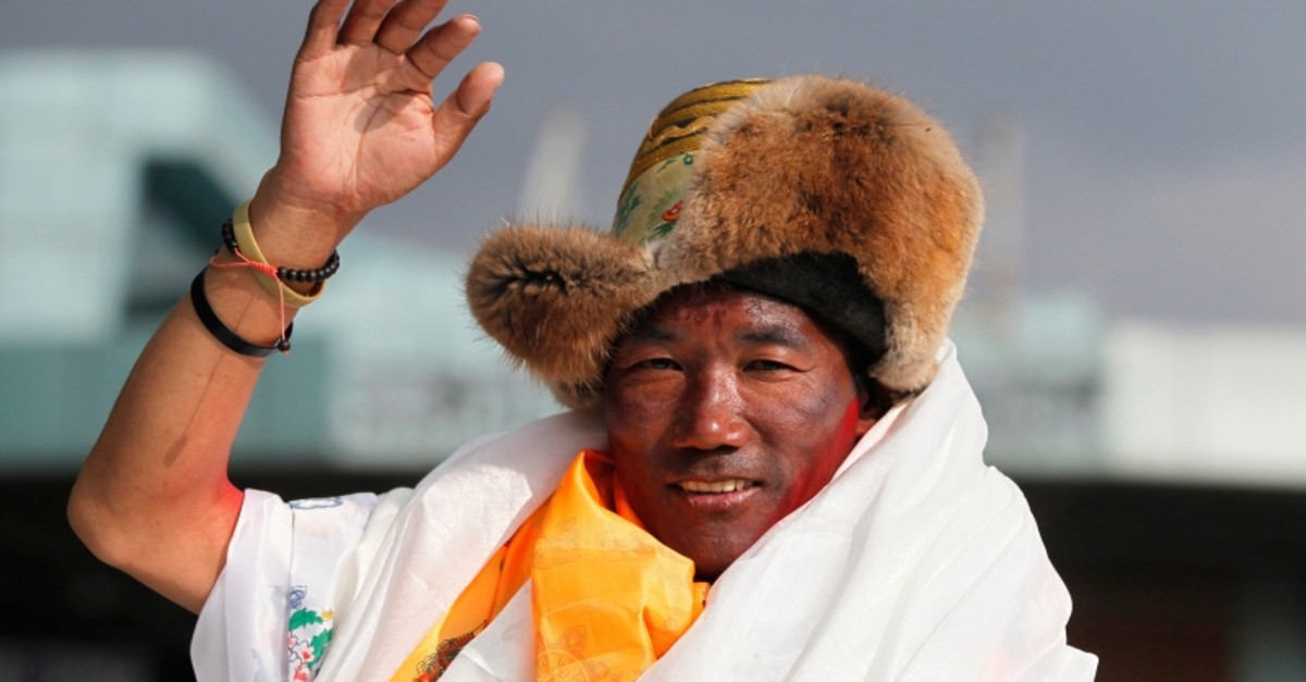 In this May 20, 2018, file photo, Nepalese veteran Sherpa guide, Kami Rita, 48, waves as he arrives in Kathmandu, Nepal. (AP Photo)