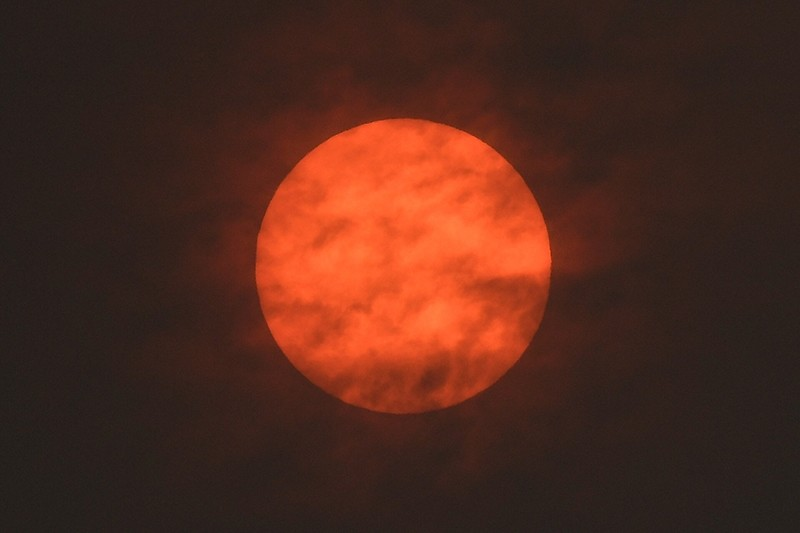 The sun is seen after dawn after the Met Office reported that storm Ophelia has drawn dust north from the Sahara, near Exeter, Britain October 16, 2017.