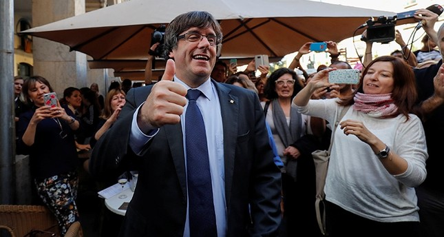 Sacked Catalan President Carles Puigdemont gestures after leaving a restaurant the day after the Catalan regional parliament declared independence from Spain in Girona, Spain, Oct. 28, 2017. (Reuters Photo)