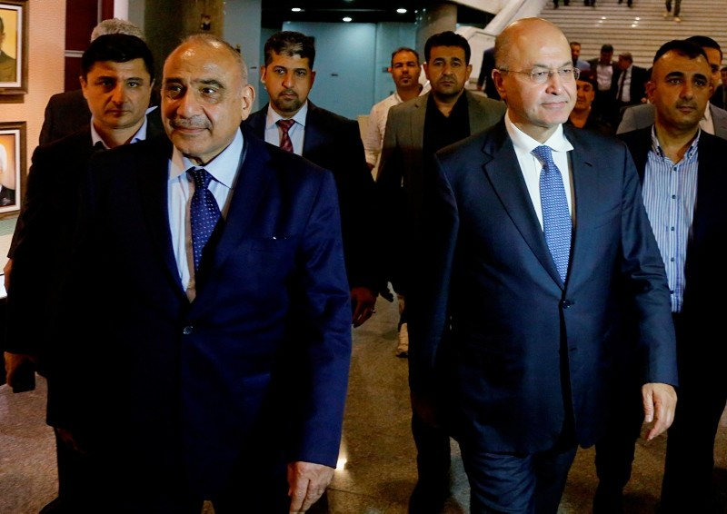 Iraq's new President Barham Salih, center right, walks with new Prime Minister Adel Abdul-Mahdi, center left, in the parliament building in Baghdad, Iraq, Tuesday, Oct. 2, 2018. (AP Photo)