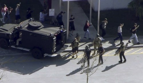 In this frame grab from video provided by WPLG-TV, students from the Marjory Stoneman Douglas High School in Parkland, Fla., evacuate the school following a shooting, Wednesday, Feb. 14, 2018 (AP Photo)