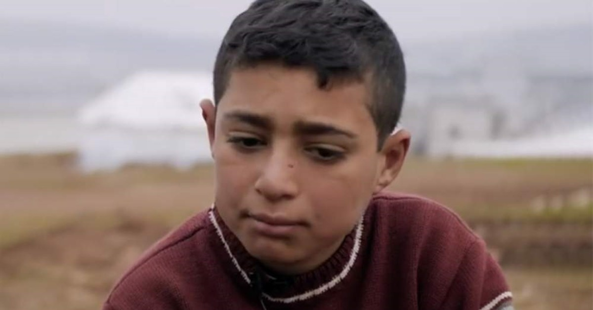 This screengrab shows the Syrian boy who was interviewed by the aid organization.