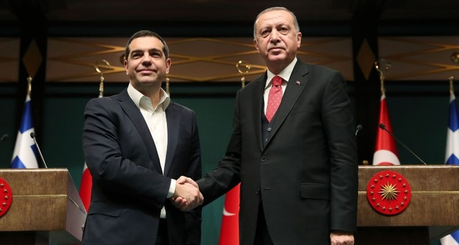 A handout photo released by the Turkish President's press office on February 5, 2019 showsErdoğan (R) shaking hands with Tsipras during a press conference at the presidential complex in Ankara. (AFP Photo)