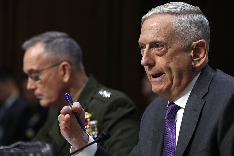 Defense Secretary Jim Mattis, right, testifies about the Department of Defense budget posture, with Joint Chiefs Chairman Gen. Joseph Dunford, left, during a Senate Armed Services Committee hearing, Thursday, April 26, 2018, in Washington. (AP Photo)