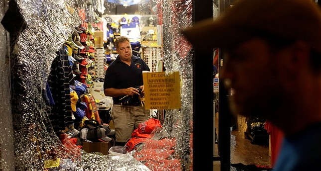 A man prepares to clean after window was smashed by demonstrators protesting the not guilty verdict in murder trial of former policeman Jason Stockley charged with 2011 shooting of a black man, in St. Louis, Mo., U.S., Sept. 16, 2017. (Reuters Photo)