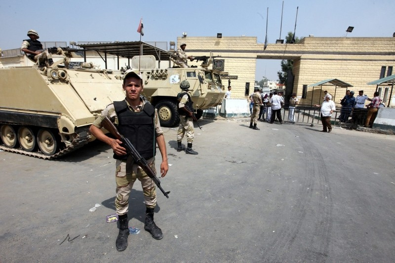 Egyptian army soldiers guard outside the Torah prison. (EPA Photo)