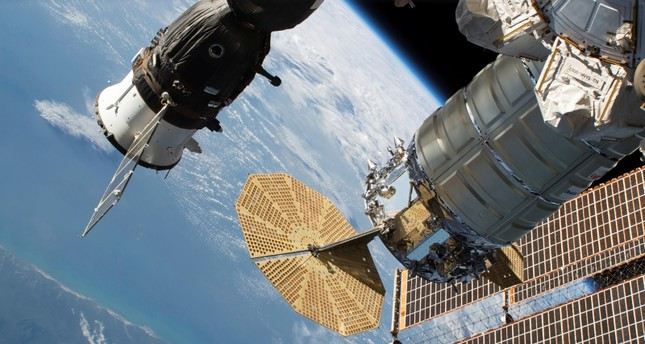 In this June 24, 2018 photo released by NASA, the Russian Soyuz MS-09 crew craft, left, and the Northrop Grumman (formerly Orbital ATK) Cygnus space freighter are attached to the International Space Station. (AP Photo)