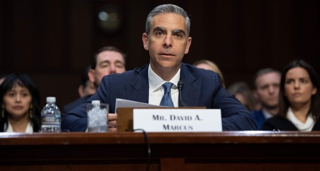 David Marcus, Head of Calibra at Facebook, testifies about Facebook's proposed digital currency called Libra, during a Senate Banking, House and Urban Affairs Committee hearing on Capitol Hill in Washington, DC, July 16, 2019. (AFP Photo)