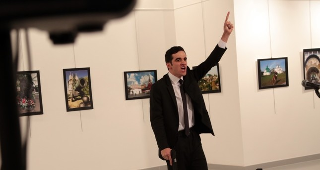 Mevlüt Mert Altıntaş, the assailant who killed the Russian envoy, at the crime scene in Ankara.