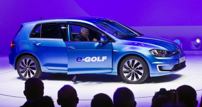 In this Jan 13, 2014 file photo the Volkswagen e-Golf fully electric vehicle is presented at the North American International Auto Show in Detroit, Michigan. (AP Photo)