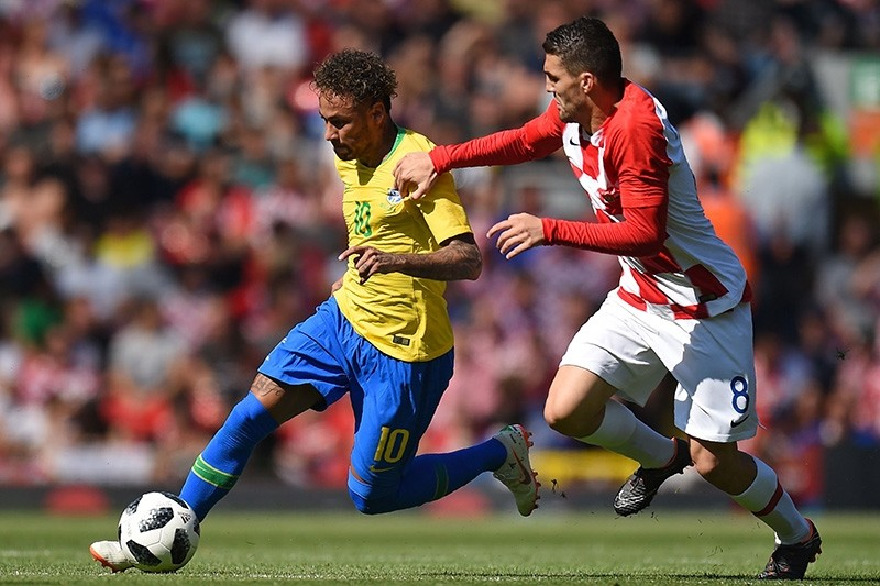 Brazil's striker Neymar (L) vies with Croatia's midfielder Mateo Kovacic during the International friendly football match between Brazil and Croatia at Anfield in Liverpool on June 3, 2018. (AFP Photo)