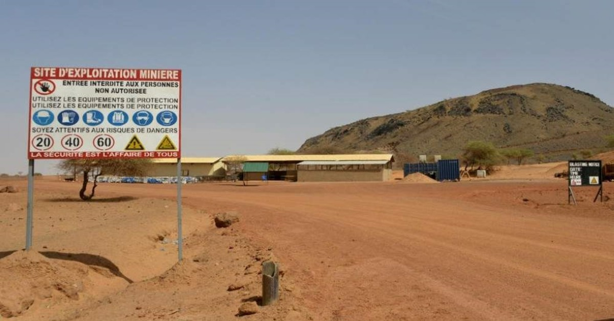 A sign is posted at the entrance of the Tambao mine in Tambao, 350 kilometers northeast of the capital, Ouagadougou on April 5, 2015, where five armed men kidnapped a Romanian mineworker the day before. (AFP)