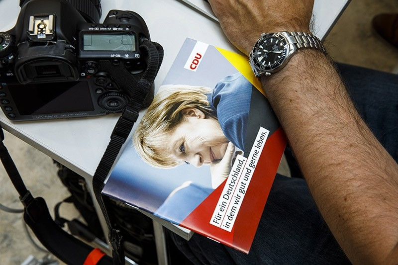 An information brochure of the Christian Democratic Union (CDU) for election campaign with pictures of the German Chancellor Angela Merkel, at the CDU headquarters in Berlin, Germany, 07 August 2017. (EPA Photo)