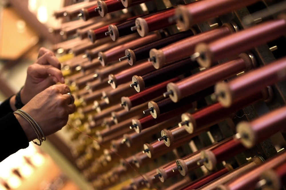 A close-up view of reels of thread in the laboratory of Antico setificio Fiorentino ancient silk factory in Florence. - Antico Setificio Fiorentino was founded in 1786 and is one of the oldest silk workshops in Europe.