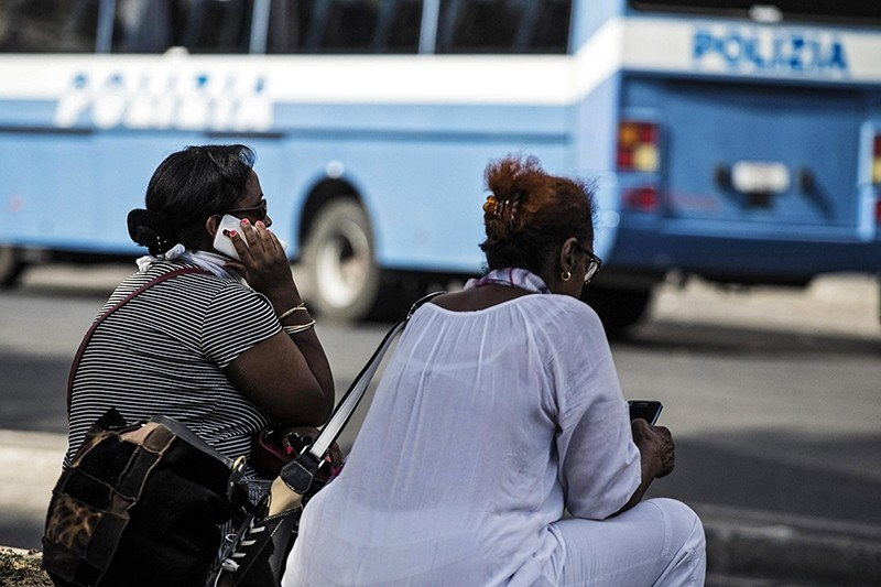 Two women sit outside the building that was occupied by migrants and refugees waiting for a residency permit, at Piazza dell'Indipendenza squre in Rome, Italy, 19 August 2017 (EPA Photo)