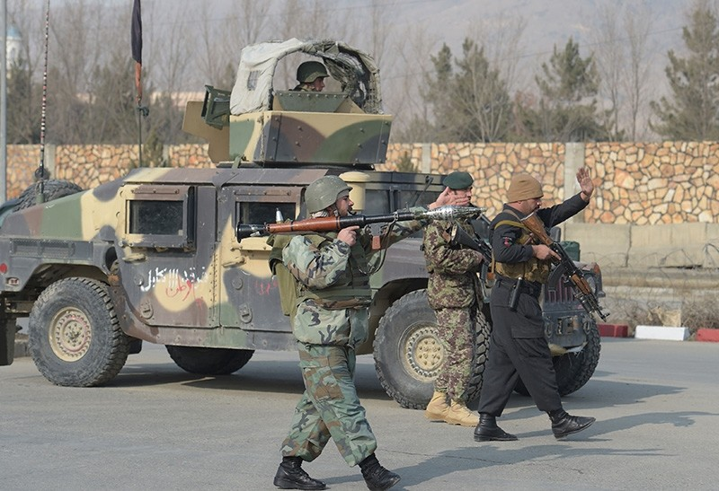 Afghan security forces stand guard at the side of an ongoing attack in Kabul on Dec. 18, 2017. (AFP Photo)