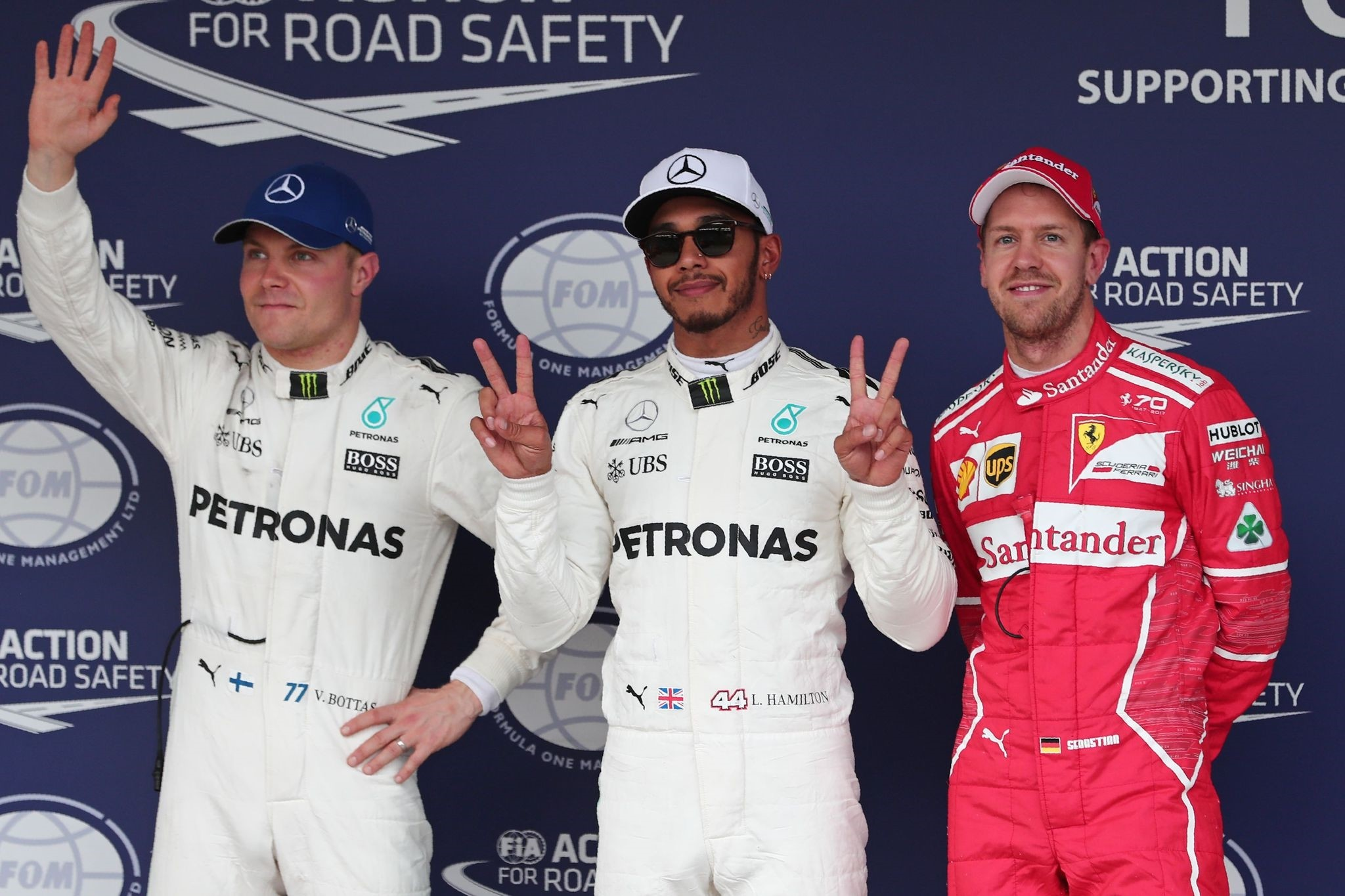Hamilton, (C) poses with Valtteri Bottas (L) and Sebastian Vettel after getting pole position for the Japanese Formula 1 Grand Prix at Suzuka Circuit, Oct. 7, 2017. (AP Photo)