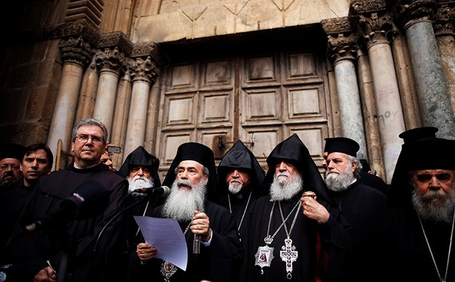 Greek Orthodox Patriarch of Jerusalem, Theophilos III, speaks during a news conference with other church leaders in front of the closed doors of the Church of the Holy Sepulchre in Jerusalem's Old City, February 25, 2018. (Reuters Photo/Amir Cohen)