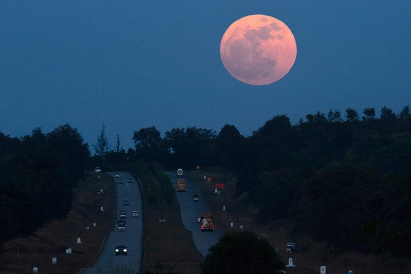 The supermoon rises over a highway near Yangon, Myanmar on Dec. 3, 2017. (AFP Photo)