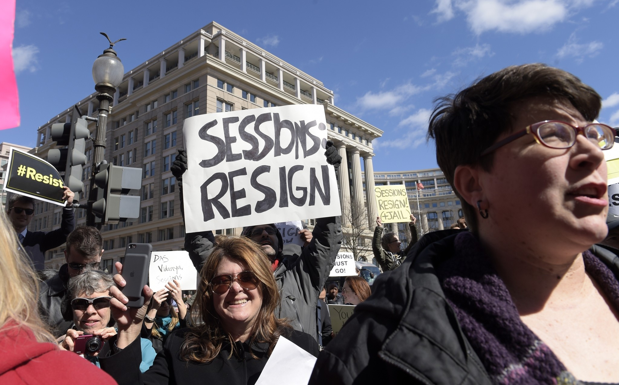 Protestors gather outside the Justice Department in Washington, Thursday, March 2, 2017, during a demonstration against Attorney General Jeff Sessions. (AP Photo)