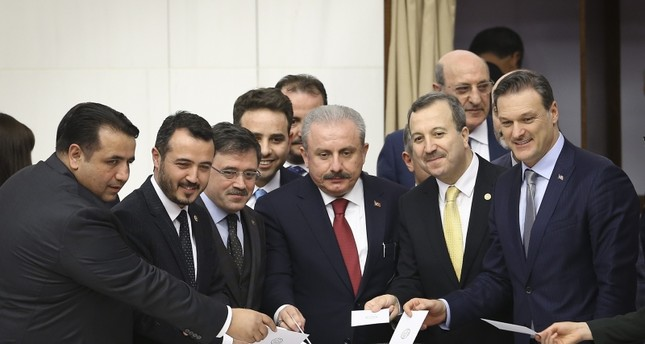 AK Party's Parliament Speaker candidate Mustafa Şentop center casts his vote at the Grand National Assembly of Turkey on Sunday, Feb. 24, 2019 AA Photo