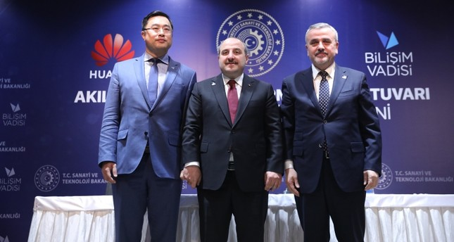 Turkish Industry and Technology Minister Mustafa Varank, Huawei Turkey General Manager Cem Zhao and Informatics Valley Board Chairman Prof. Habip Asan pose during a signing ceremony in Gebze, Kocaeli, northwestern Turkey, March 29, 2018. AA Photo