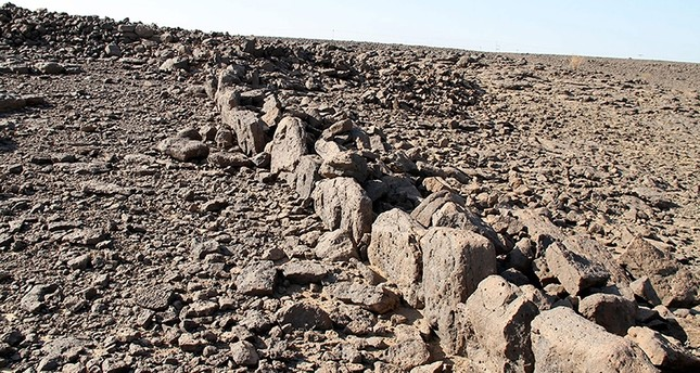 This undated handout picture released by the University of Western Australia shows the mysterious ancient structures built from stone in undisclosed locations across the desert in Saudi Arabia (AFP Photo)