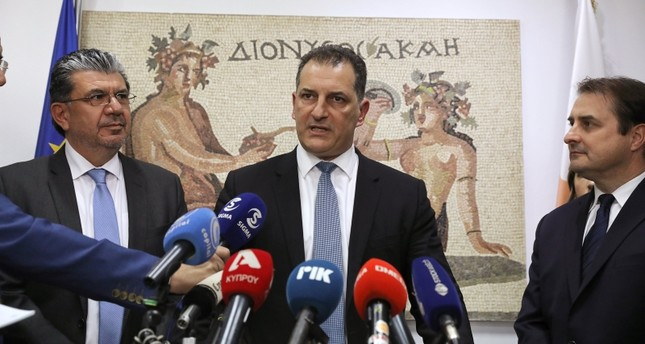 Greek Cypriot Minister of Energy, Yiorgos Lakkotrypis, speaks during a news conference while Tristan Aspray, ExxonMobil's Vice President of Exploration for Europe, Russia and the Caspian, looks on in Nicosia, Feb. 28, 2019. (Reuters Photo)