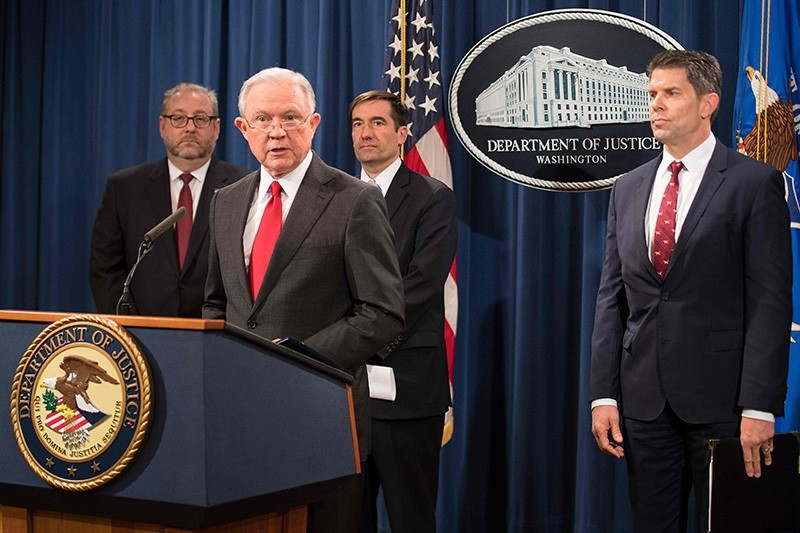 Attorney General Jeff Sessions announces the creation of a new initiative to crack down on Chinese intelligence officials pilfering intellectual property from US corporations through hacking and espionage on Nov. 1, 2018. (AFP Photo)