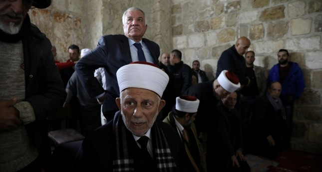 Chairman of the Waqf Council, Abdel-Azeem Salhab, attends Friday prayers together with other Palestinian Muslims inside the Golden Gate near Al-Aqsa Mosque in Jerusalem's Old City Feb. 22 (Reuters Photo)