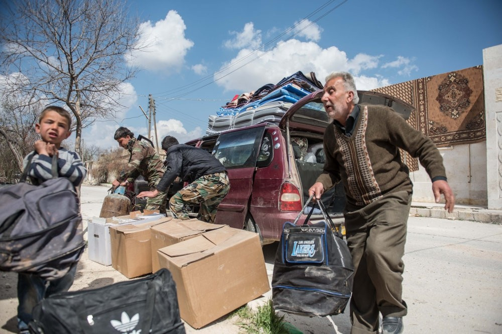 Members of the Khalil family returning to al-Bab as reconstruction process continue. (AA Photo)