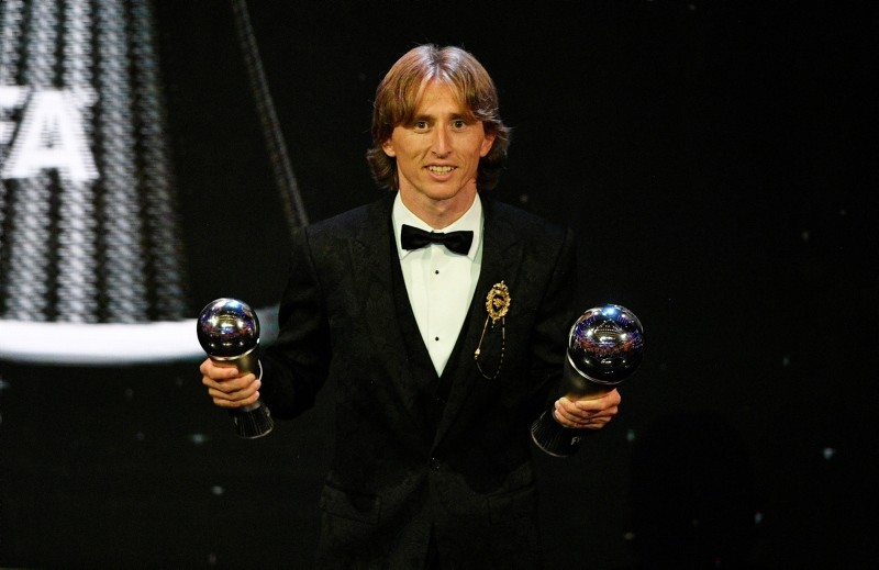 Real Madrid player Luka Modric poses with trophies after receiving the Best FIFA Men's Player award during the Best FIFA Football Awards 2018 in London, Great Britain, 24 September 2018. (EPA Photo)
