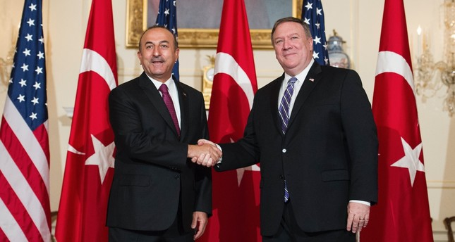 Foreign Minister Mevlüt Çavuşoğlu (L) with Secretary of State Mike Pompeo in the State Department in Washington, June 4.
