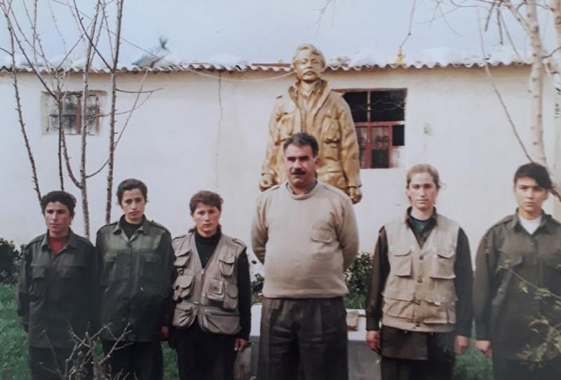 Gu00fclizar Tau015fdemir (2ndR) poses alongside Abdullah u00d6calan (C), the jailed leader of the PKK terrorist group. (AA Photo)