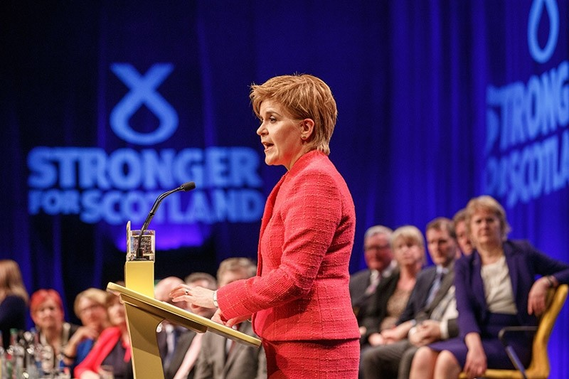 Scotland's First Minister and the leader of the Scottish National Party, Nicola Sturgeon, addresses the audience at the Scottish National Party Spring Conference in Aberdeen, Scotland 18 March 2017. (EPA Photo)