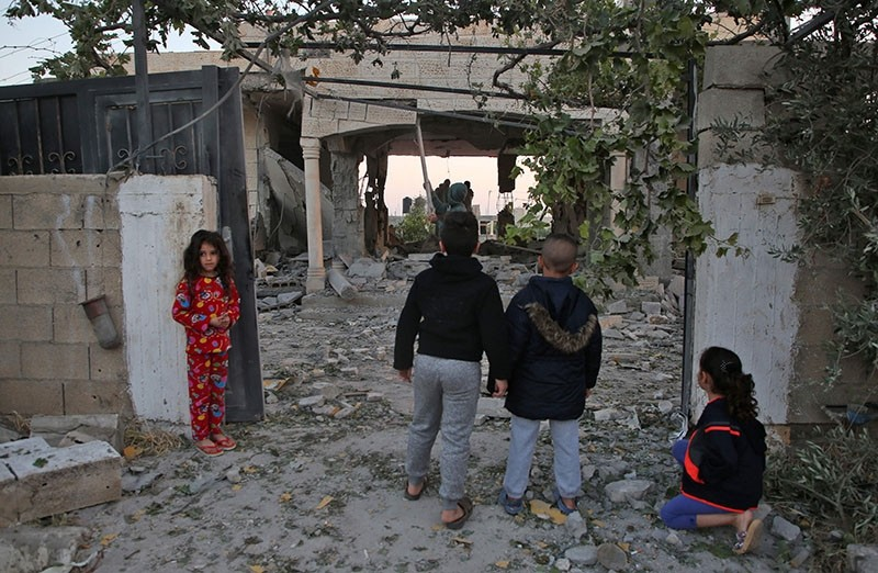 Palestinian children check the house of a man suspected of murdering an Israeli rabbi in January 2018, after it was demolished by Israeli forces on April 24, 2018, in the West Bank city of Jenin. (AFP Photo)