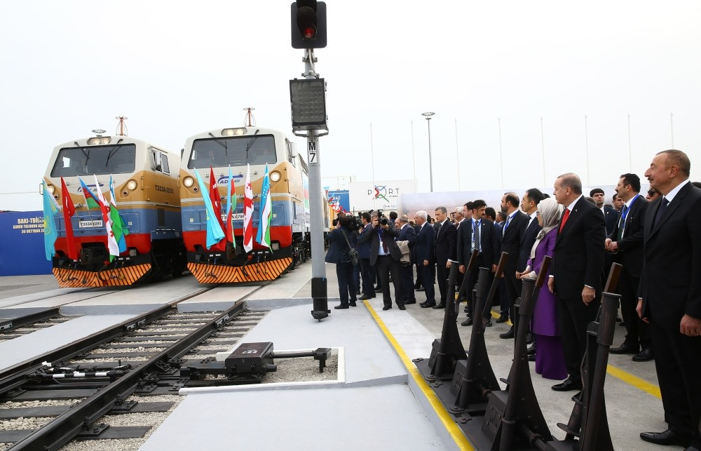 Erdou011fan (2nd R), accompanied by first lady Emine Erdou011fan (3rd R), Azerbaijan's Aliyev (R), Kazakh, Uzbek and Georgian leaders and their delegations look at trains during the inauguration ceremony of the Baku-Tbilisi-Kars Railway, Baku, Oct. 30.