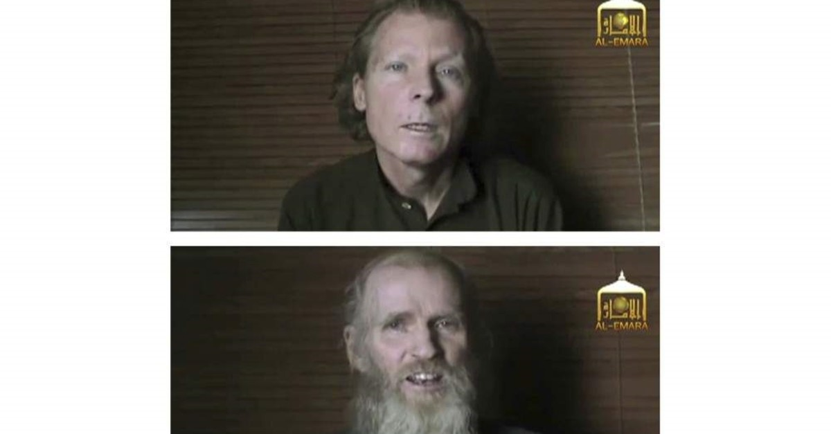 This two-photo combination image taken from a video released on June 21, 2017, by the Taliban spokesman Zabihullah Mujahid, shows kidnapped teachers Australian Timothy Weeks (top)and American Kevin King, who were both abducted by the insurgents in Afghanistan in August 2016. (EL-EMARA Taliban via AP)