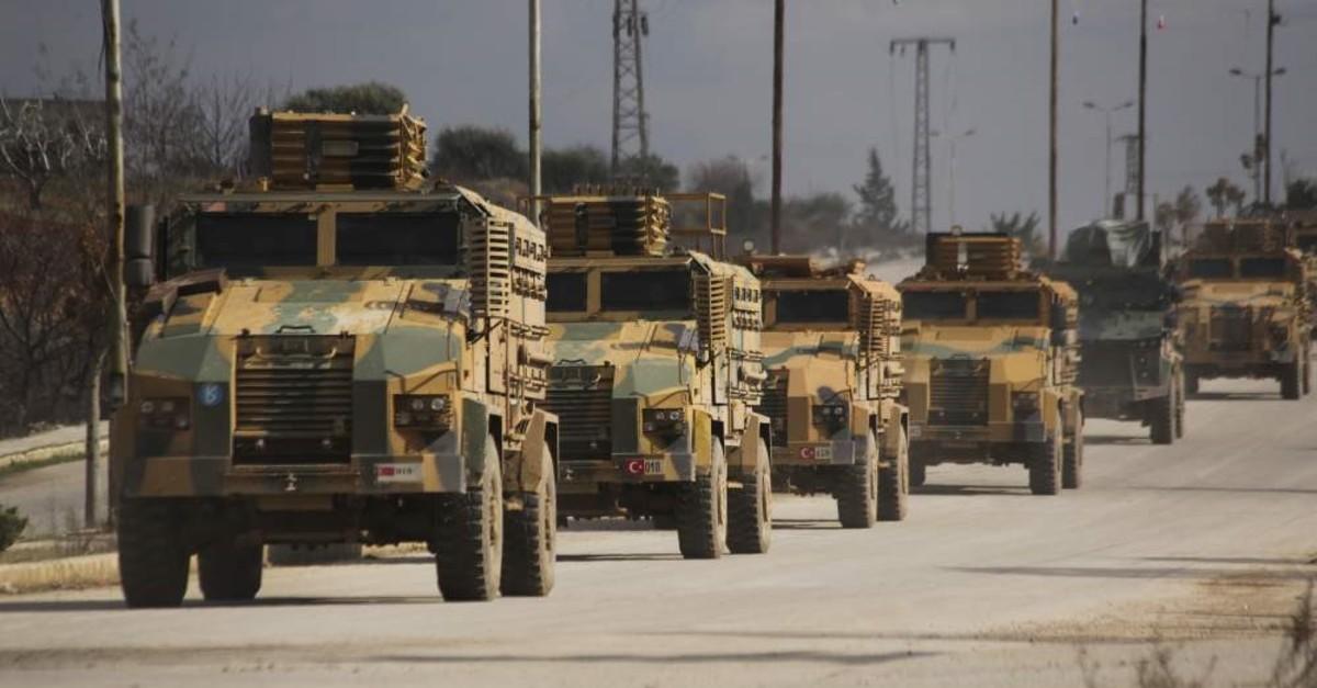 Turkish military convoy drives in Idlib province, Syria, Saturday, Feb. 22, 2020. (AP Photo/Ghaith Alsayed)